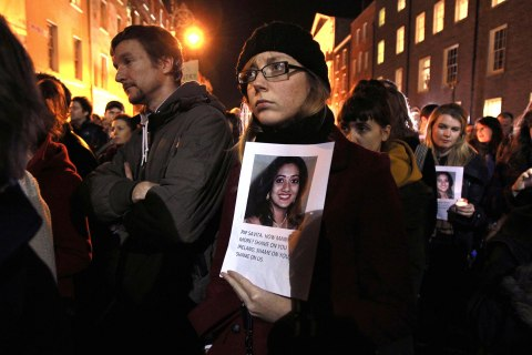 image: Protestors hold pictures of Savita Halappanavar, an Indian woman who was allegedly refused a pregnancy termination, as they gather outside Leinster House,  the Irish Parliament building, during a demonstration in favor of abortion legislation in Dublin, Ireland, Nov. 14, 2012.