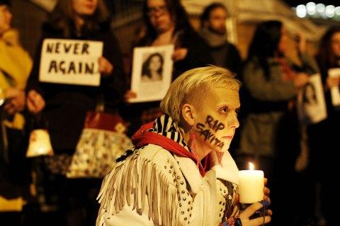 image: Hanna Graham joins a protest candle lit vigil for Savita Halappanavar outside Belfast City Hall, Northern Ireland, Nov. 15, 2012.