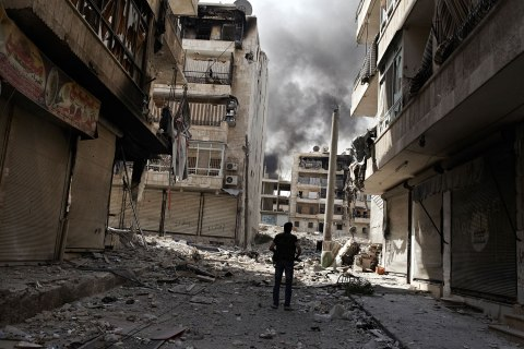 image: Free Syrian Army fighter Mohammad Jaffar patrols a street in Bustan Al Basha, one of Aleppo's most volatile front lines, Oct. 22, 2012.