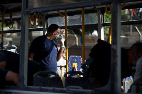 image: Emergency services work the scene of an explosion on a bus in Tel Aviv, Nov. 21, 2012.