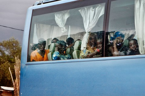 A bus carrying passengers from Gao in Mali's Islamist-controlled north to the capital, Bamako, makes a stop in Mopti, Mali Sept. 27, 2012.