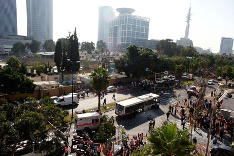 Israeli emergency personnel stand at scene after explosion on a bus in Tel Aviv