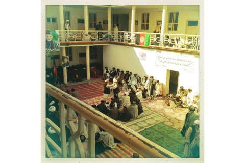 Tribal elders greet one another at a peace jirga in a Sangin, Afghanistan, district office