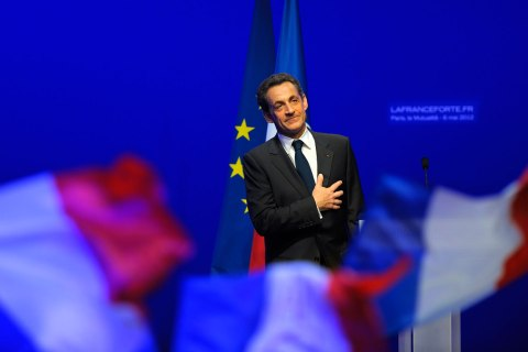 image: Former president Nicolas Sarkozy reacts after his defeat for re-election in the second round vote of the 2012 French presidential elections as he appears on stage before UMP party supporters at the Mutualite meeting hall in Paris, May 6, 2012.