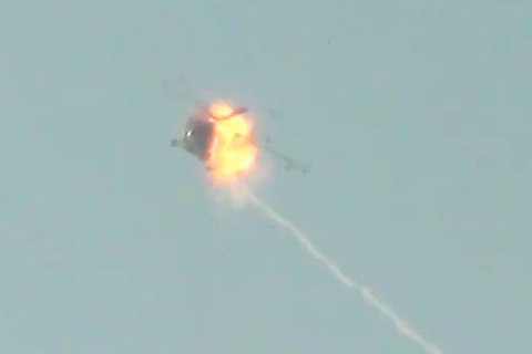 Screen grab from video footage from anti-government source claiming to show a Russian-made attack helicopter taking fire in mid-flight from rebel forces on the ground in Syria. Posted on YouTube on Nov. 27, 2012.