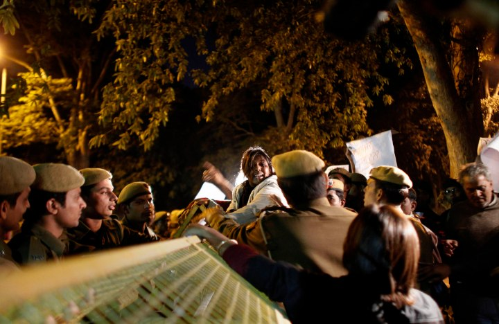 image: A member of Common Man's Party, enters into a scuffle with policemen during a protest outside the residence of Delhi state government Chief Minister Sheila Dikshit in New Delhi on Dec. 19, 2012. The alleged hours-long gang-rape and near fatal beating of a 23-year-old student on a bus in New Delhi triggered outrage and anger across the country Wednesday as Indians demanded action from authorities who have long ignored persistent violence and harassment against women.