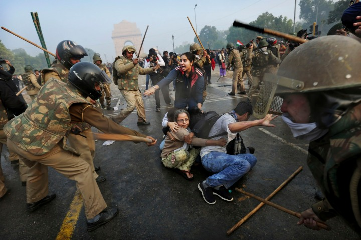image: Indian police beat protesters with sticks during violent demonstrations near the India Gate against a gang rape and brutal beating of a 23-year-old student on a bus last week, in New Delhi, Dec. 23, 2012.