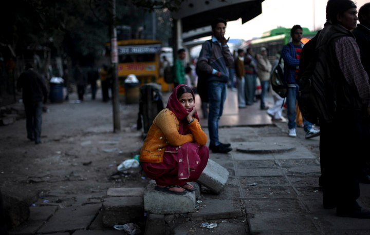 image: A woman watches a candlelight vigil outside the hospital, where a young woman rape victim is being treated, in New Delhi, Dec. 20, 2012. The gang-rape and near fatal beating of a 23-year-old student on a bus in New Delhi triggered outrage and anger across the country as Indians demanded action from authorities who have long ignored persistent violence and harassment against women.