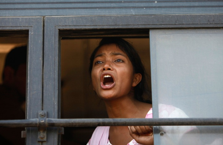 image: A demonstrator shouts slogans from inside a bus after she was detained by police near the presidential palace Rashtrapati Bhavan during a protest rally organised by various women's organisations in New Delhi Dec. 21, 2012.