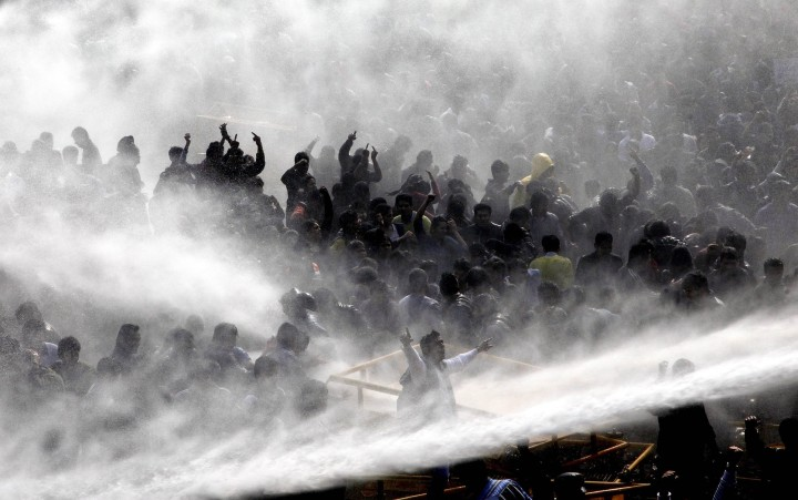 image: New Delhi Police use water canons to disperse thousands of protestors who gathered outside the Indian President's house to protest against the recent brutal gang rape in New Delhi, India, Dec. 22, 2012.