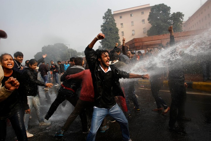 image: Indian police use water cannon to disperse protesters demonstrating against a gang rape and brutal beating of a 23-year-old student on a bus in New Delhi, India, Dec. 23, 2012.