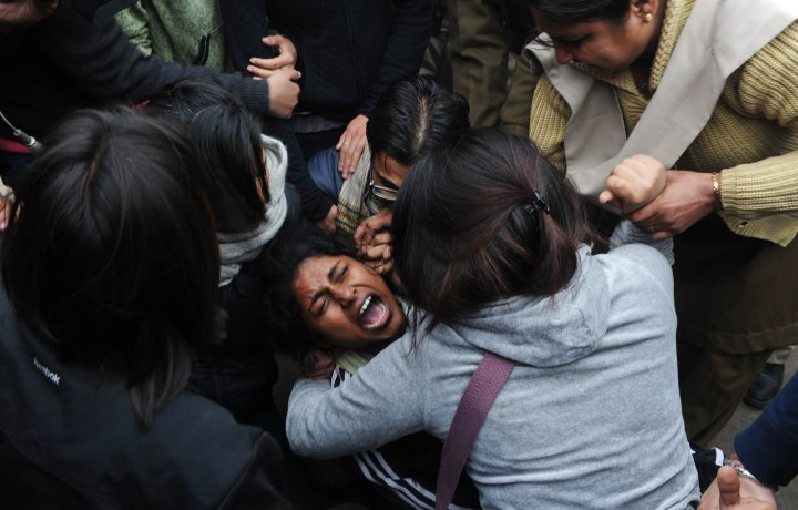 image: Indian demonstrators are arrested by police during a protest calling for better safety for women following the rape of a student last week, in front the India Gate monument in New Delhi on Dec. 23, 2012. In the biggest protest so far, several thousand college students rallied at the India Gate in the heart of the capital where they were baton-charged, water cannoned and tear gassed by the police.