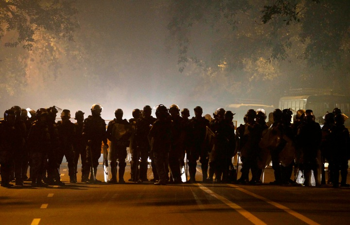 image: Indian police in riot gear stand guard near the residence of Indian Home Minister Sushil Kumar Shinde in the wake of protests against the brutal gang-rape of a woman on a moving bus in New Delhi, India, Dec. 24, 2012. Authorities shut down roads in the heart of India's capital on Monday to put an end to a week of demonstrations against the brutal gang-rape of a woman on a moving bus.