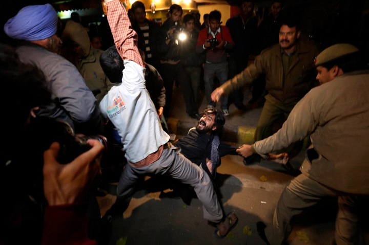 image: Demonstrators scuffle with police during a protest in New Delhi, Dec. 24, 2012.