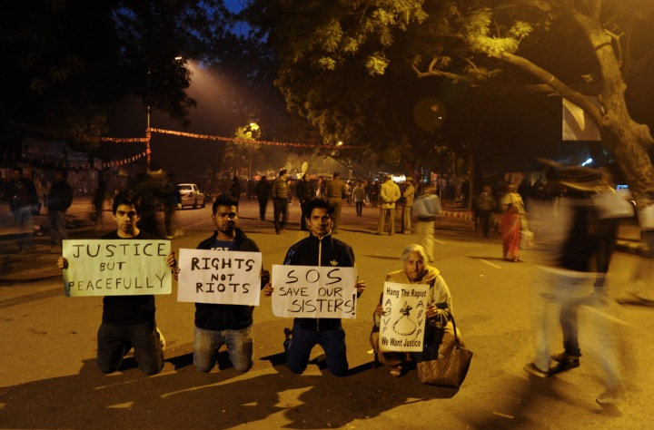image: Demonstrators hold placards at Jantar Mantar following a weekend of clashes between demonstrators and police in New Delhi, Dec. 24, 2012. Indian Prime Minister Manmohan Singh has appealed for calm and vowed to protect women as police struggled to quell increasing outrage over sex crimes following the gang-rape of a student.