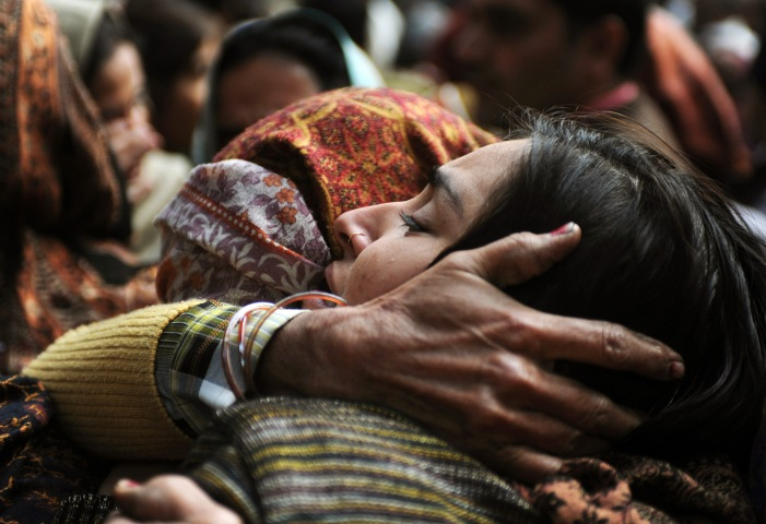 image: Relatives of Indian policeman Subash Tomar mourn during his funeral in New Delhi on Dec. 25, 2012.