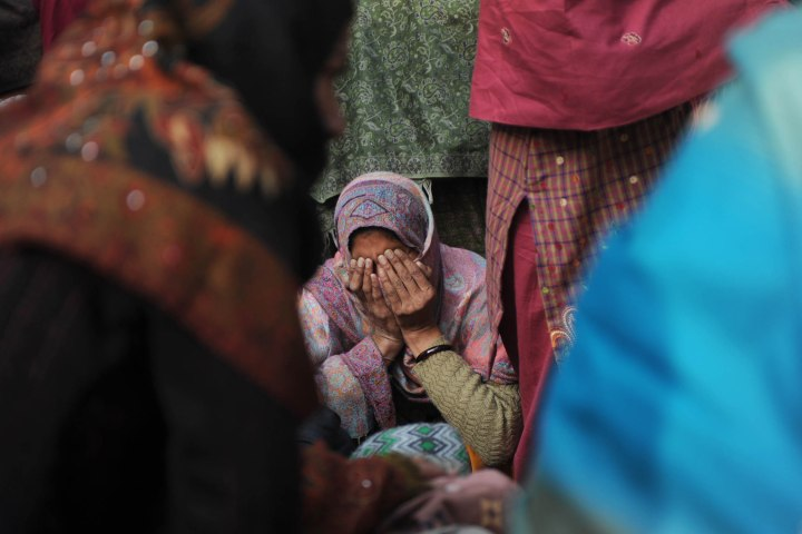 image: A relative of Indian policeman Subash Tomar mourns during his funeral in New Delhi on Dec. 25, 2012.