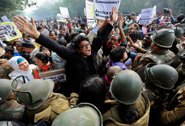 image: Demonstrators shout slogans as they are surrounded by the police during a protest rally in New Delhi Dec. 27, 2012. Several hundred people gathered in India's capital  in a bid to rekindle mass protests over the gang rape and ferocious beating of a young woman.