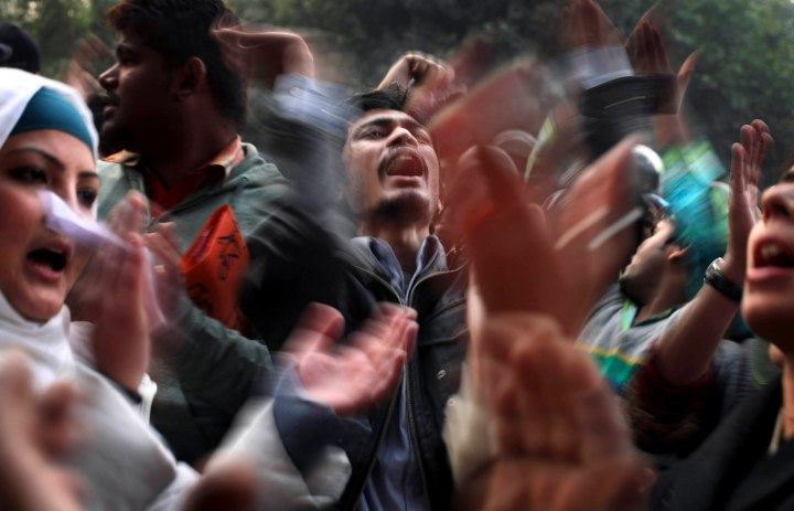 image: Protesters shout slogans while demonstrating against the recent gang-rape of a young woman in a moving bus in New Delhi, Dec. 27, 2012. Indian Prime Minister Manmohan Singh pledged to take action to protect the nation's women while the young rape victim was flown to Singapore for treatment of severe internal injuries.
