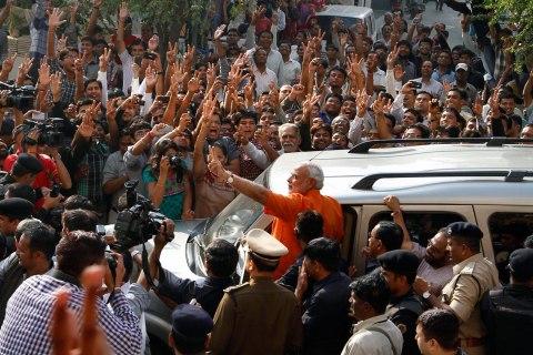 image: Indian state of Gujarat chief minister Narendra Modi greets his supporters after casting his vote in the second phase of Gujarat state assembly elections in Ahmadabad, India, Dec. 17, 2012