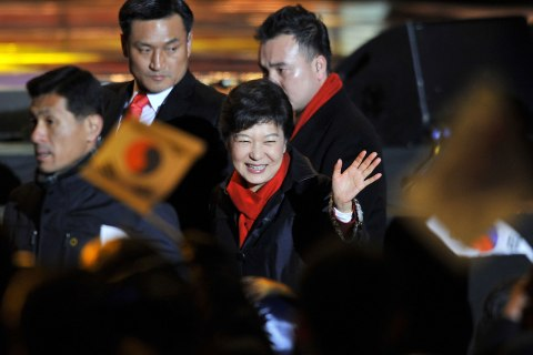image: South Korea's president-elect Park Geun-Hye waves to supporters as she arrives to deliver a victory speech on a stage in the centre of Seoul, Dec. 19, 2012.