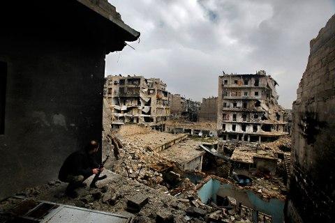 image: Abu Firuz, the commander of Liwa Salahadin, a Kurdish military unit fighting along side rebel fighters, watches the besieged district of Karmel al-Jabl in eastern Aleppo, Dec. 6, 2012.