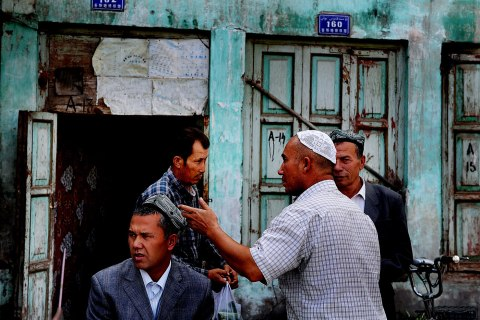 image: Uighur men are seen in the old town Kashgar district, Xinjiang province, China, Sept. 5, 2009.