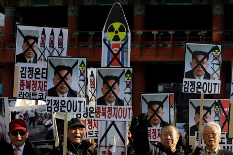 South Korean protesters shout slogans during a rally denouncing North Korea's rocket launch in Seoul, South Korea on Dec. 12, 2012.