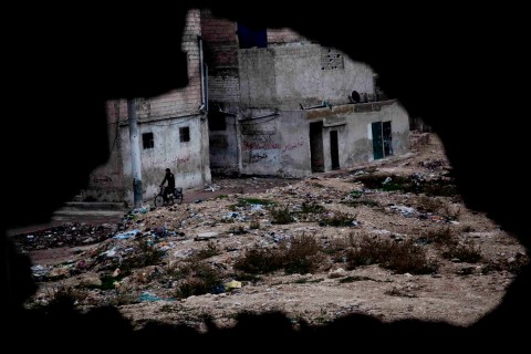 image: The dwarves from The HobbitThe view through a sniper hole in the Old City in Aleppo, Syria on Nov. 18, 2012.