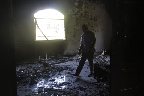 A Libyan man walks through the damaged U.S. consulate in Benghazi on Sept. 13, 2012, following the Sept. 11 attack that killed U.S. Ambassador J. Christopher Stevens and three other Americans.