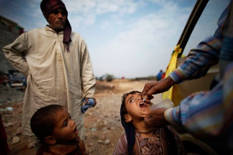 A child is administered polio drops by a mobile unit during an anti-polio drive in New Delhi