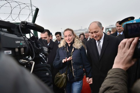 France's Florence Cassez, flanked by French Foreign minister Laurent Fabius and her Lawyer Franck Berton arrive for a press conference at Roissy airport on Jan. 24, 2013 in Roissy, France.