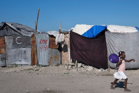 image: A Haitian girl walks through a camp for people displaced by the January 2010 earthquake in Port-au-Prince, Jan. 3, 2013.