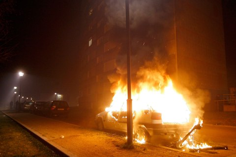 image: A car burns after being torched during New Year celebrations in Strasbourg's district of Neuhof, France, Jan. 1, 2013.
