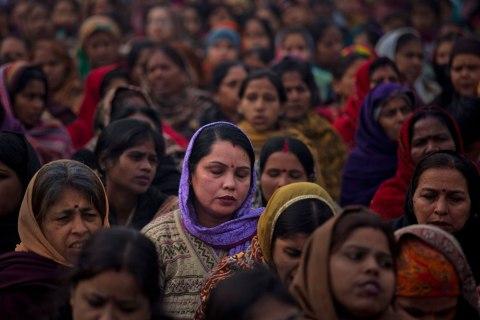 image: Indian women offer prayers for a gang rape victim at Mahatma Gandhi memorial in New Delhi, Jan. 2, 2013.