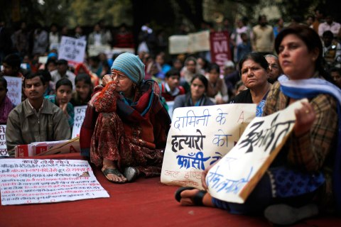 Indians listen to a speaker during a protest against the alleged inaction by the Indian government in the case of the gang rape of a 23-years old student in a bus a month ago in New Delhi, Jan. 16, 2013.