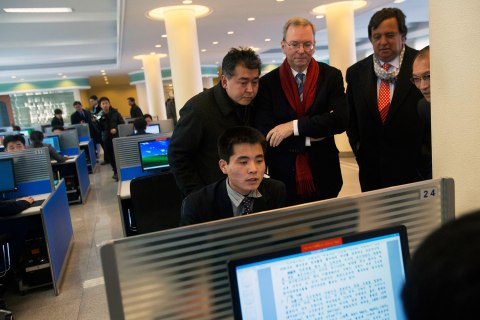 image: Executive Chairman of Google, Eric Schmidt, third from left, and former New Mexico governor Bill Richardson, second from right, watch as a North Korean student surfs the Internet at a computer lab during a tour of Kim Il Sung University in Pyongyang, North Korea, Jan. 8, 2013.