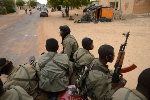 Malian soldiers enter the historic city of Timbuktu,  Jan. 28, 2013.