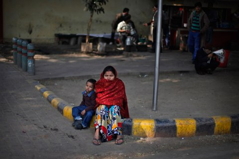 image: An Indian woman and her son watch a protest in New Delhi, Jan. 13, 2013.