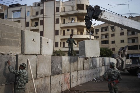 Image: Egyptian army engineers and soldiers build a third line of concrete blocks outside of the Egyptian presidential palace in Cairo, Dec. 9, 2012