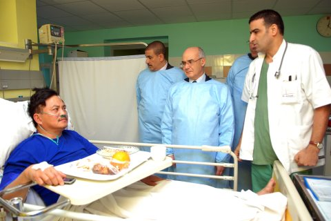 Algerian Minister of Energy and Mines Youcef Yousfi visits an injured former hostage from philippines, at the clinic Algiers Al Azhar, in Algiers, Algeria, on  Jan. 18 2013.