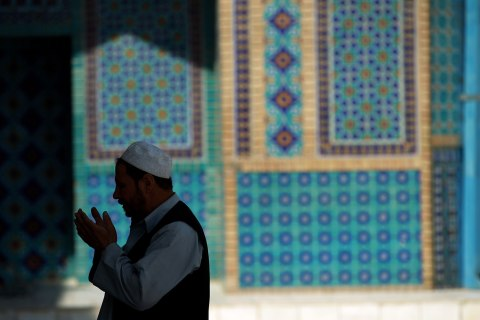 Man prays in mosque in Afghanistan