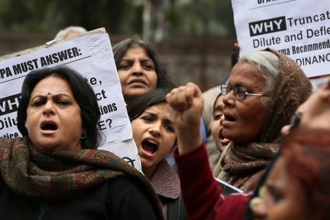 Activists from different women organizations shout slogan against government during a protest, in New Delhi, India on Feb. 4, 2013.