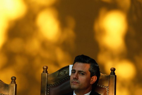 Mexico's President Enrique Pena Nieto attends a ceremony to receive the Keys to the City at the National Museum in San Jose Feb. 20, 2013.