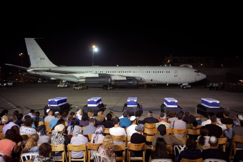 The coffins of Itzik Colangi, Amir Menashe, Maor Harush, Elior Price and Kochava Shriki, who were killed in an attack in Bulgaria, are seen during a ceremony at Ben Gurion International Airport near Tel Aviv, July 20, 2012.