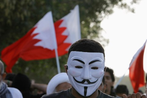 A protester wears a Guy Fawkes mask in Bahrain.