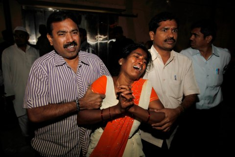 A woman cries out after seeing the body of her husband who was killed in a bomb blast in Hyderbad, India.