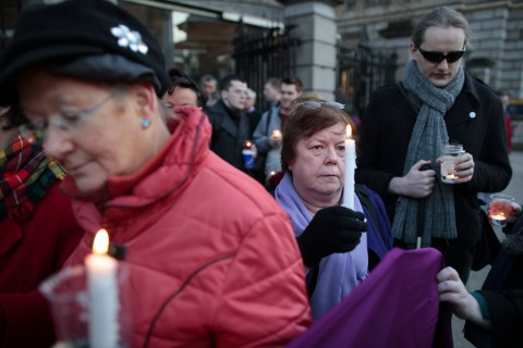 Relatives of victims of the Magdalene Laundries hold a candle lit vigil in solidarity with Justice for Magdalene Survivors
