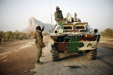 A convoy of Malian troops makes a stop to test some of their weapons near Hambori, northern Mali, on the road to Gao, Feb. 4, 2013.