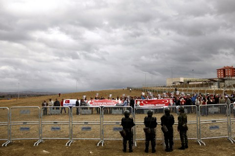 Protestors hold banners prior the Ergenekon trial in front of heavily guarded Silivri prison, Turkey, Sept. 7, 2009.